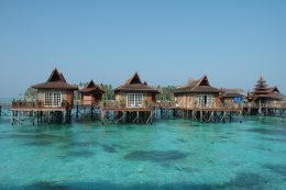 The bungalows are built over the azure sea.