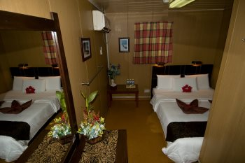 Standard double room with attached bathroom. Twin room configuration is also available